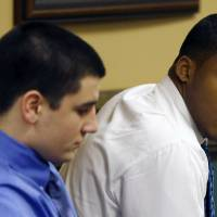 Photo - Trent Mays, 17, left, and co-defendant 16-year-old Ma'lik Richmond sit in court before the start of the third day of their trial on rape charges in juvenile court on Friday, March 15, 2013 in Steubenville, Ohio. Mays and Richmond are accused of raping a 16-year-old West Virginia girl in August of 2012. (AP Photo/Keith Srakocic, Pool)