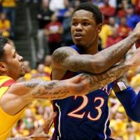 Photo - Iowa State guard Chris Babb (2) guards Kansas guard Ben McLemore (23) during the first half of an NCAA college basketball game, Monday, Feb. 25, 2013, in Ames, Iowa. (AP Photo/Justin Hayworth)