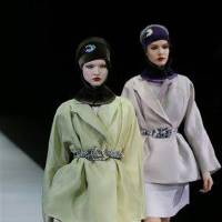 Photo - Models wear creations for Emporio Armani women's Fall-Winter 2013-14 collection, part of the Milan Fashion Week, unveiled in Milan, Italy, Sunday, Feb. 24, 2013. (AP Photo/Luca Bruno)