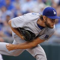 Photo - Los Angeles Dodgers pitcher Clayton Kershaw throws to a batter in the first inning of a baseball game against the Kansas City Royals at Kauffman Stadium in Kansas City, Mo., Tuesday, June 24, 2014. (AP Photo/Colin E. Braley)