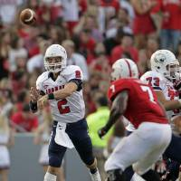 Photo -   South Alabama quarterback Ross Metheny (2) passes against North Carolina State during the first half of an NCAA college football game in Raleigh, N.C., Saturday, Sept. 15, 2012. (AP Photo/Gerry Broome)