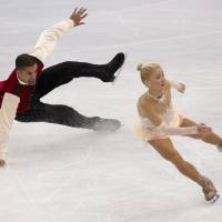 Photo - Robin Szolkowy falls as he and Aliona Savchenko of Germany compete in the pairs free skate figure skating competition at the 2014 Winter Olympics, Wednesday, Feb. 12, 2014, in Sochi, Russia. (AP Photo/Bernat Armangue)
