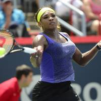 Photo - Serena Williams returns to Caroline Wozniacki, of Denmark, at the Rogers Cup tennis tournament Friday, Aug. 8, 2014,  in Montreal. (AP Photo/The Canadian Press, Paul Chiasson)