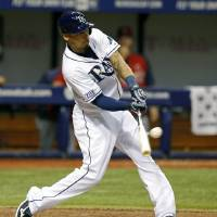 Photo - Tampa Bay Rays' Desmond Jennings singles in two runs during the fourth inning of a baseball game against the St. Louis Cardinals Wednesday, June 11, 2014, in St. Petersburg, Fla. (AP Photo/Mike Carlson)