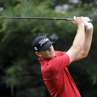 Photo - Brendan Steele watches his drive on the 10th tee during the first round of the Travelers Championship golf tournament in Cromwell, Conn., Thursday, June 19, 2014. (AP Photo/Fred Beckham)