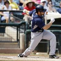 Photo - San Diego Padres' Xavier Nady hits a double during the first inning of a spring exhibition baseball game against the Texas Rangers, Sunday, March 23, 2014, in Surprise, Ariz. Two runs scored on the hit. (AP Photo/Darron Cummings)