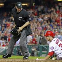 Photo -   Washington Nationals' Bryce Harper (34) slides across home plate as Arizona Diamondbacks catcher Miguel Montero loses the ball during the fourth inning of a baseball game, Wednesday, May 2, 2012, in Washington. At center is home plate umpire Bill Welke. (AP Photo/Haraz N. Ghanbari)