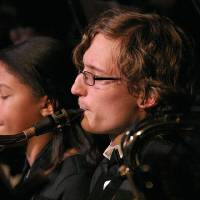 Photo - Hannah Key, left, and David Sprehe, members of the Putman City High School Wind Symphony, perform during the school's winter concert. The event included performances from the school's wind symphony, symphonic band and jazz ensemble. Photos by Terry Groover, The Oklahoman
