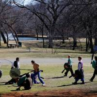 Photo - A group of people practice Dagorhir battle games at E.C. Hafer Park. The group meets on Saturdays in the park. PHOTO BY BRYAN TERRY, THE OKLAHOMAN.  BRYN TERRY - THE OKLAHOMAN