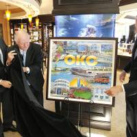 Photo - Mayor Mick Cornett, with former mayors Ron Norick and Kirk Humphreys, unveils a rendering of the 2013 Oklahoma City Christmas ornament celebrating the MAPS program. The ornaments can be bought downtown at BC Clark Jewelers. Photo by Paul B. Southerland, The Oklahoman  PAUL B. SOUTHERLAND
