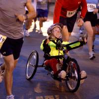 Photo - A wheelchair participant gets help from other runners on the Walnut Street bridge during the 8th annual Oklahoma City Memorial Marathon on Sunday, April 27, 2008, in Oklahoma City, Okla. BY SARAH PHIPPS, THE OKLAHOMAN  ORG XMIT: KOD
