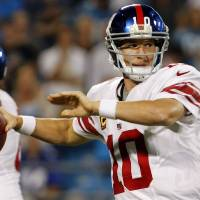 Photo -   New York Giants quarterback Eli Manning (10) throws against the Carolina Panthers during the first quarter of an NFL football game in Charlotte, N.C., Thursday, Sept. 20, 2012. (AP Photo/Bob Leverone)