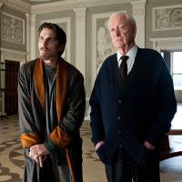 Photo -   FILE - This undated image released by Warner Bros. Pictures shows Christian Bale as Bruce Wayne, left, and Michael Caine as Alfred in a scene from the
