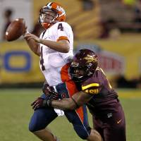 Photo -   Illinois quarterback Reilly O'Toole (4) is sacked by Arizona State safety Chris Young during the second half of an NCAA college football game, Saturday, Sept. 8, 2012,in Tempe, Ariz. (AP Photo/Matt York)