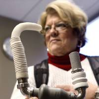 Photo - Pam Golden of Longtown holds a model of an LVAD (left ventricular assistance device). A similar pump was  implanted in her body to improve her circulation system.  Photographed at  Integris Baptist Hospital on Monday, Jan. 14, 2013.     Photo by Jim Beckel, The Oklahoman