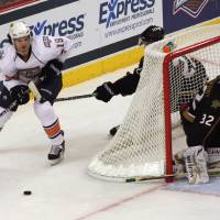 Photo - OKC's Ryan O'Marra (18) skates around the defending goal during a game between the Oklahoma City Barons and the Texas Stars at the Cox Convention Center in Oklahoma City, Saturday, Oct. 15, 2011.  Photo by Garett Fisbeck, The Oklahoman ORG XMIT: KOD