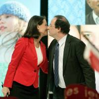 Photo - FILE - In this March 29, 2007 file photo, Socialist French presidential candidate Segolene Royal, left, kisses her partner Secretary-General of the Socialist Party Francois Hollande during a meeting in Limoges, central France. Royal, French President Francois Hollande's former partner, has been named Wednesday April, 2, 2014 as Minister of Environment and Energy. (AP Photo/Francois Mori, File)