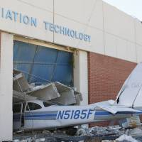 Photo - An airplane is damaged in the Aviation Technology building on the campus of the Canadian Valley Technology Center in El Reno, on June 2. A massive tornado roared through the area on May 31 causing widespread damage and flooding. AP Photo  Alonzo Adams