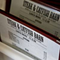 Photo - The classic menus at the Steak and Catfish Barn in Oklahoma City. Photo by Chris Landsberger, The Oklahoman  CHRIS LANDSBERGER - CHRIS LANDSBERGER
