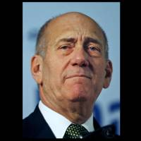 Photo - FILE - In this Wednesday, Jan. 14, 2009 file photo, Israel's former prime minister Ehud Olmert speaks during a conference at the Plaza hotel in Jerusalem. An Israeli court on Monday convicted Olmert in a wide-ranging bribery case, a verdict that could send him to prison and that is likely to rule out any immediate hopes for a political comeback. (AP Photo/Dan Balilty, File)
