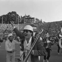 Photo - COLLEGE FOOTBALL: The Stanford University band goes wild on the field at the end of the Cal-Stanford game in Berkeley, thinking they had won, as the scoreboard says, 20-19 with no time left, Nov. 20, 1982.  Little did they know that Cal's Kevin Moen weaved his way through hundreds of people including the band to score a touchdown after time had run out, giving Cal a 25-20 win over Stanford.  (AP Photo/Carl Viti) ORG XMIT: APHS