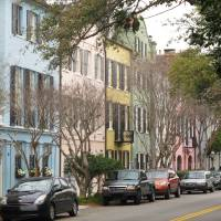 Photo - One of the most iconic vistas in Charleston, S.C., Rainbow Row, is seen in this March 11, 2013 photograph. It's free to walk through the city's historic district to see these and other historic homes.  (AP Photo/Bruce Smith)