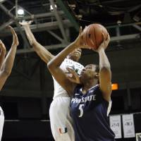 Photo - Penn State's Talia East (5) goes for the score as against the defense of Miami's Morgan Stroman during the first half of an NCAA women's college basketball game in Miami, Thursday, Nov. 29, 2012. (AP Photo/Jeffrey M. Boan)