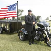 Photo - Brian Gray, who runs a motorcycle hearse business called Final Ride, demonstrates his service Tuesday at Chapel Hill Memorial Gardens Cemetery in Oklahoma City. Photos By Paul Hellstern, The Oklahoman
