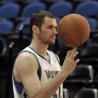 Photo -   In this Oct. 1, 2012 photo, Minnesota Timberwolves NBA star basketball player Kevin Love spins a ball for the team photographer during media day in Minneapolis. Love is beginning the first season of a four-year, $60 million contract extension and says when