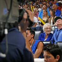Photo - Dale and Lois Higgins prepare to appear on the Kiss Cam during a timeout in the April 11 game between the Oklahoma City Thunder and the New Orleans Pelicans at Chesapeake Energy Arena in Oklahoma City.  Photo by Bryan Terry,  The Oklahoman  BRYAN TERRY -