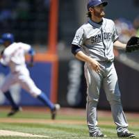 Photo - New York Mets' Curtis Granderson, back left, runs past San Diego Padres starting pitcher Ian Kennedy after hitting a first-inning solo home run duringa baseball game in New York, Sunday, June 15, 2014. The Mets won 3-1. (AP Photo/Kathy Willens)