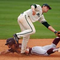 Photo - Texas A&M's Nick Banks steals second base as George Mason's Chris Cook defends during the third inning of an NCAA college baseball tournament regional game, Saturday, May 31, 2014, at Reckling Park in Houston. (AP Photo/Houston Chronicle, Eric Christian Smith) MANDATORY CREDIT