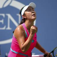 Photo - Peng Shuai, of China, reacts after a shot against Belinda Bencic, of Switzerland, during the quarterfinals of the 2014 U.S. Open tennis tournament, Tuesday, Sept. 2, 2014, in New York. (AP Photo/Mike Groll)