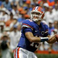 Photo - ** FILE ** In this Aug. 30, 2008 file photo, University of Florida quarterback Tim Tebow looks for a receiver during the first half of a college football game against Hawaii in Gainesville, Fla. Tebow didn't have the same gaudy numbers this season as he did last year, but he might have been even more valuable to the top-ranked Gators. If voters see it the same way, Tebow would become the second player to win the Heisman Trophy in consecutive years. (AP Photo/John Raoux, File) ORG XMIT: NY172