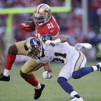 Photo -   San Francisco 49ers running back Frank Gore runs with the ball and is hit by St. Louis Rams cornerback Cortland Finnegan during the fourth quarter of an NFL football game in San Francisco, Sunday, Nov. 11, 2012. (AP Photo/Jeff Chiu)