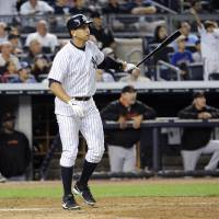 Photo - New York Yankees' Alex Rodriguez watches his grand slam during the seventh inning of an interleague baseball game against the San Francisco Giants, Friday, Sept. 20, 2013, at Yankee Stadium in New York. (AP Photo/Bill Kostroun)