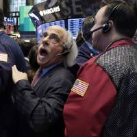 Photo - Trader Peter Tuchman, center, works on the floor of the New York Stock Exchange, Friday, Jan. 25, 2013. Stocks are opening higher on Wall Street ahead of what is expected to be more upbeat data on housing from the government. (AP Photo/Richard Drew)