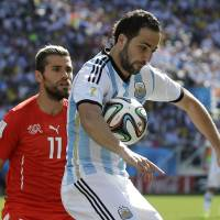Photo - Argentina's Gonzalo Higuain controls the ball during the World Cup round of 16 soccer match between Argentina and Switzerland at the Itaquerao Stadium in Sao Paulo, Brazil, Tuesday, July 1, 2014. (AP Photo/Sergei Grits)