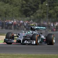 Photo - Germany's Nico Rosberg of Mercedes rounds the track during a practice session before the British Formula One Grand Prix at Silverstone, England, Friday, July 4, 2014. The British Formula One Grand Prix will be held on Sunday, July 6, 2014. (AP Photo/Jon Super)