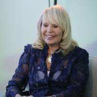 Photo - Shelly Sterling, wife of former Los Angeles Clippers owner Donald Sterling, pauses for photos after an interview with The Associated Press Thursday, Aug. 28, 2014, in Los Angeles. Shelly Sterling negotiated a landmark deal for $2 billion to sell the Clippers to Steve Ballmer, former CEO of Microsoft. (AP Photo/Jae C. Hong)