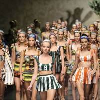 Photo -   Models wear creations part of the Dolce & Gabbana women's Spring-Summer 2013 fashion collection, during the fashion week in Milan, Italy, Sunday, Sept. 23, 2012. (AP Photo/Antonio Calanni)