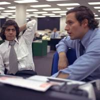 Photo -       Bob Woodward, right, and Carl Bernstein, whose reporting of the Watergate case won them a Pulitzer Prize, sit in the newsroom of the Washington Post in 1973. The pair showed how exhausting real news reporting can be, but how important it is to get the story right. (AP Photo)