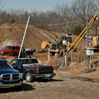 Photo - Crews work Monday on a section of the Keystone Pipeline near Boley where a woman locked herself to the pipeline in protest. She was later arrested.  CHRIS LANDSBERGER - CHRIS LANDSBERGER