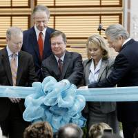 Photo - Larry Nichols, center, Devon Energy executive chairman, pulling a pin on a ribbon during a commemoration ceremony of the Devon Energy Center in Oklahoma City Tuesday, Oct. 23, 2012. From left are Mayor Mick Cornett, John Richels, Devon president and CEO, Larry Nichols, Gov. Mary Fallin and Jon Pickard, building architect. After six years of planning and three years of construction Devon Energy held a ceremony commemorating the completion of the center. Photo by Paul B. Southerland, The Oklahoman