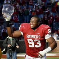 Photo - Gerald McCoy was a big part of OU's Bedlam winning streak. Photo by Bryan Terry, The Oklahoman Archive