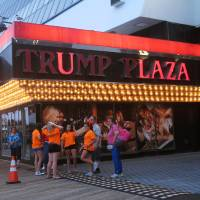 Photo - This July 24, 2014 photo shows several lights burned out in the illuminated facade of the Trump Plaza Hotel Casino in Atlantic City, N.J. On Tuesday Aug. 5, 2014, Donald Trump sued Trump Entertainment Resorts, seeking to force the company to remove his name from its two Atlantic City casinos, Trump Plaza and the Trump Taj Mahal, alleging the company had allowed the casinos to fall into disrepair and tarnish the real estate mogul's personal brand. (AP Photo/Wayne Parry)