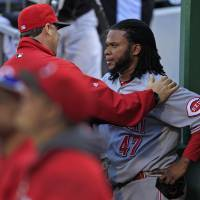 Photo -   Cincinnati Reds starting pitcher Johnny Cueto (47) listens to Cincinnati Reds pitching coach Bryan Price, left, after being pulled from the game after pitching the seventh inning of a baseball game against the Pittsburgh Pirates in Pittsburgh Sunday, Sept. 30, 2012. The Reds won 4-3, with Cuerto not figuring in the decision. (AP Photo/Gene J. Puskar)