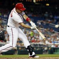 Photo - Washington Nationals' Ryan Zimmerman hits a one RBI double during the fifth inning of a baseball game against the Philadelphia Phillies at Nationals Park Tuesday, June 3, 2014, in Washington. (AP Photo/Alex Brandon)