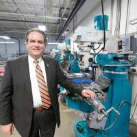 Photo -  Greg Winters stands beside a manual milling machine in precision machining shop on the Holt Campus of Canadian Valley Technology Center.     Steve Gooch