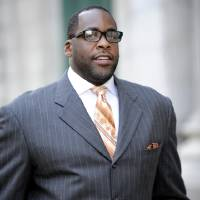 """Photo - FILE - In this Sept. 27, 2012 file photo, former Detroit mayor Kwame Kilpatrick makes his way to U.S. Federal Court in Detroit. Businessman Karl Kado, who held contracts at Detroit's convention center, said Monday, Dec. 3, 2012 that he was a """"hostage"""" who felt compelled to pay thousands of dollars to then-Mayor Kwame Kilpatrick and his father or lose work. Kado told jurors that he personally delivered $5,000 to $10,000 to Kilpatrick """"three or four times."""" He said he also delivered money through a top mayoral aide and separately paid $200,000 to $300,000 to Kilpatrick's father, Bernard. Kado is a crucial witness at the corruption trial, which began in September. (AP Photo/The Detroit News, David Coates)"""